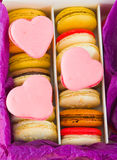French colorful macarons with hearts in box Stock Photo