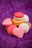 French colorful macarons with hearts Stock Image
