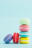 French colorful macarons stacks on pastel background, retro Styl Stock Images