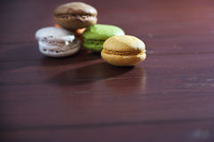 French colorful macarons on a wooden floor, morning snack Royalty Free Stock Photo