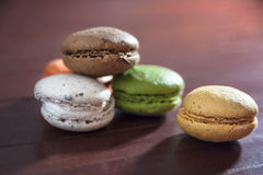 French colorful macarons on a wooden floor, morning snack Royalty Free Stock Photography
