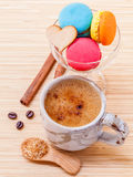 French colourful macaroons and a cup of coffee. Royalty Free Stock Photography