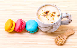 French colourful macaroons and a cup of coffee. Stock Images