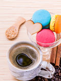 French colourful macaroons and a cup of coffee. Stock Photos