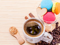 French colourful macaroons and a cup of coffee. Royalty Free Stock Images