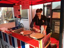 French Cook Prepare Crepe at La Cigala French Market. AUCKLAND,JUNE 4: Cook  prepare French crepe, a thin pancake, usually made from wheat flour at the La Cigale Royalty Free Stock Photography