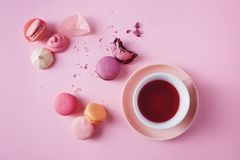 French cookies on pink background. Sweet french macarons and meringues on pink background. Lovely pastel colored homemade cookies Stock Photography