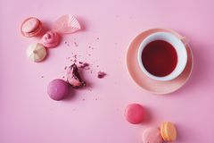 French cookies on pink background. Sweet french macarons and meringues on pink background. Lovely pastel colored homemade cookies Stock Image