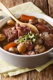 French Coq au vin food: stewed in wine with vegetables and Royalty Free Stock Images