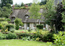 French Country Cottage. Thatched Timber Framed House in Normandy, France with a cottage garden to the front Royalty Free Stock Image