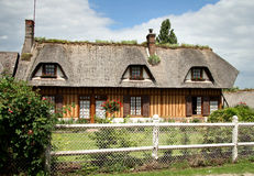 French Country Cottage. Thatched Timber Framed Village House in Normandy, France with a cottage garden to the front Stock Photos