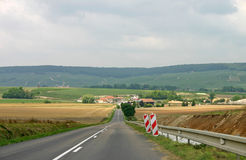 French Country Road. A straight country road, in the French countryside Royalty Free Stock Image