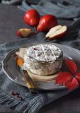 French cow's milk cheese and red pears Stock Photography