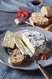French cow& x27;s milk cheese, red pears and wineglass Royalty Free Stock Photography