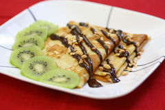 French crepes with chocolate and kiwi Stock Photos