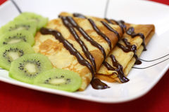 French crepes with chocolate and kiwi Royalty Free Stock Photo