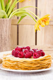 French Crepes with fresh raspberries and powder sugar Stock Images