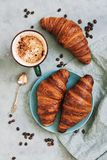 French croissant roll with coffee. Appetizing breakfast with pastries. View from above. French croissant roll with coffee. Appetizing breakfast with pastries royalty free stock photography