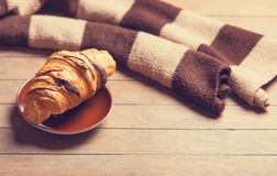 French croissant and scarf Royalty Free Stock Photo