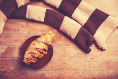 French croissant and scarf Royalty Free Stock Photography