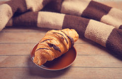 French croissant and scarf Stock Image
