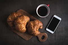 French croissants and coffee Stock Photos