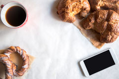 French croissants and cup of coffee Stock Image