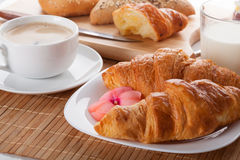 French croissants with a cup of coffee Stock Images