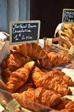 French croissants for sale. Fresh french croissants for sale at the market in Paris, France Royalty Free Stock Photo