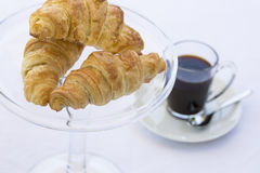 French Croissants on glass dish with coffee Royalty Free Stock Photo