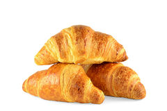 French croissants isolated on white background. Three fresh, French croissants isolated on white background Royalty Free Stock Images