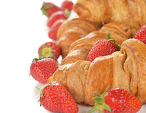 French croissants and strawberry Stock Photos