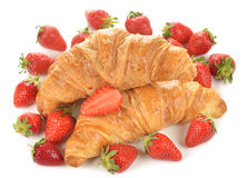French croissants and strawberry. On a white background royalty free stock photo