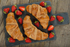 French croissants and strawberry Stock Image