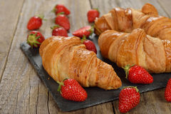 French croissants and strawberry Royalty Free Stock Photography