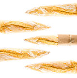 French Crusty  Baguette of whole wheat bread on a white backgrou Royalty Free Stock Image