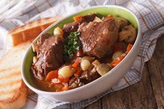 French cuisine: beef Bourguignon close up in a bowl. horizontal Royalty Free Stock Image