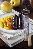 French cuisine: black pudding with apples and wineglass Royalty Free Stock Photography