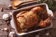 French cuisine: Chicken with forty cloves of garlic close-up. ho Stock Photo