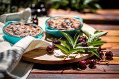 Homemade cake. French cherry pie. On a wooden background. Stock Images