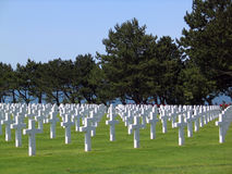 French D-Day cemetary in Normandy. Rows of grave stones mark burial grounds for world war two casualties Royalty Free Stock Photo