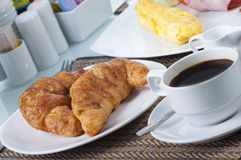 French day starter. Croissant and black coffee, great breakfast continental style Stock Images