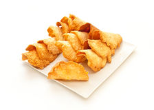 French delicacy almond pastry. French delicacy pastry tuile with almond on the square dish Stock Images