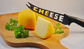 French delicatessen, cheese. Cutting board, knife for cheese Royalty Free Stock Photo