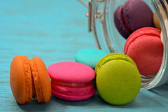 French delicious dessert macaroons on wooden table Royalty Free Stock Photos