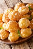 French dessert chouquette profiteroles with pearly sugar and min. T closeup on the table. vertical Vector Illustration