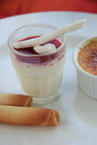 French desserts: blancmange. French dessert: blancmange with berry sauce and meringue royalty free stock photos