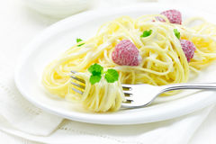 French dish Spaghetti with raspberry. French dessert dish Spaghetti with raspberry and cream fresh Stock Image
