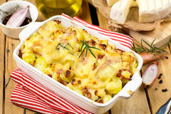 French dish Tartiflette with potatoes, reblochon cheese and bacon stock photo