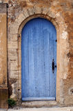 French door. Blue painted door in an old house in Gordes in the Provence, France Stock Image